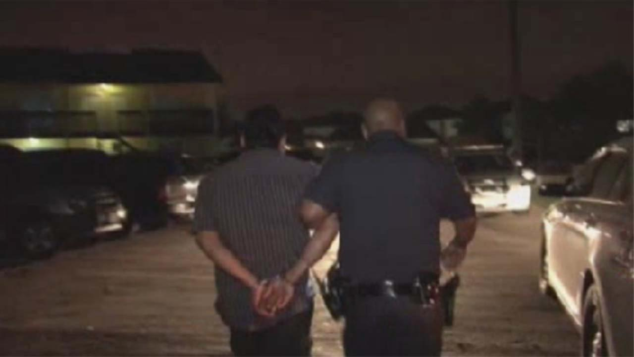 Suspect taken out in handcuffs by a Harris County Sheriffs deputy