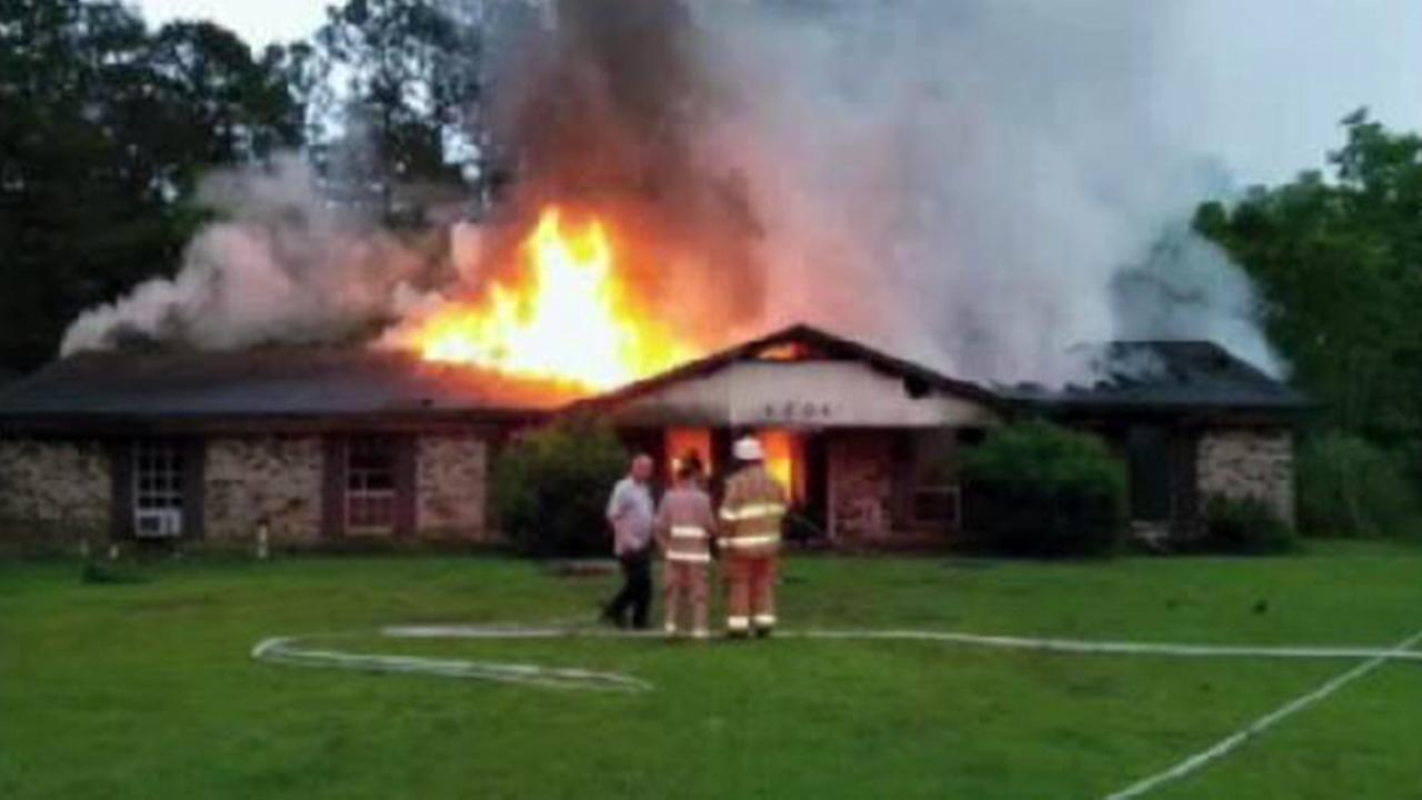 Burning home in Escatawpa, Mississippi