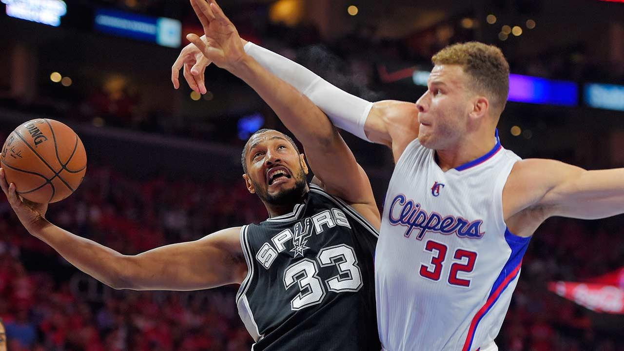 San Antonio Spurs center Boris Diaw, left, of France, shoots as Los Angeles Clippers forward Blake Griffin defends during the first half of Game 7.