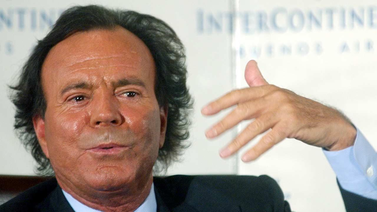 In this April 12, 2004 file photo, Spanish singer Julio Iglesias gestures as he talks with reporters during a news conference to promote his new album Divorce in Buenos Aires.