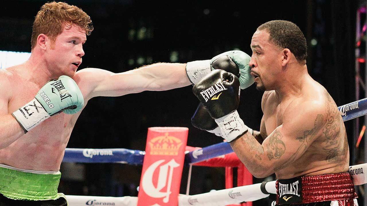 Saul Canelo Alvarez, left, lands a a jab to the face of James Kirkland during a 154-pound fight on Saturday, May 9, 2015, in Houston. Alvarez won the bout.