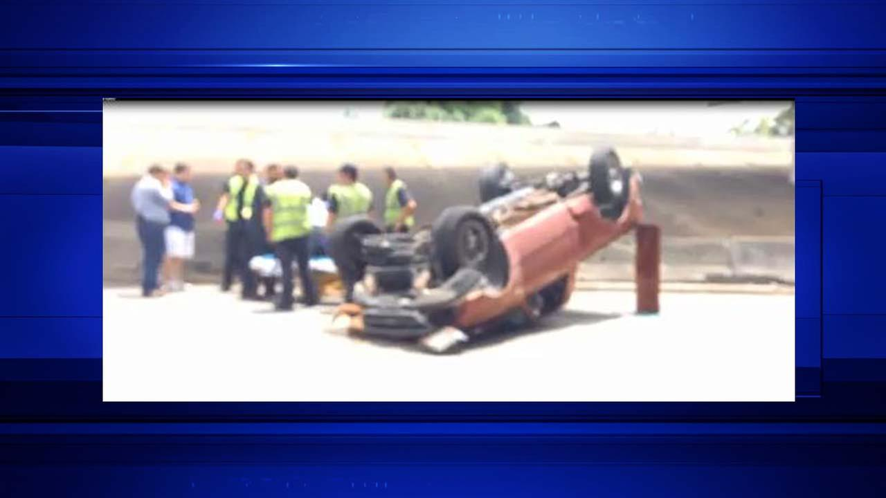 Truck flipped over on the Southwest Freeway at 288