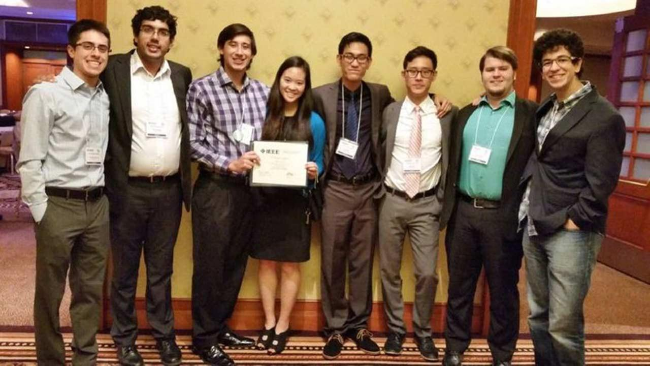 Madeline Yin and teammate Cameron McKay, hold the second place certificate they won at the IEEE Region 5 Conference in New Orleans