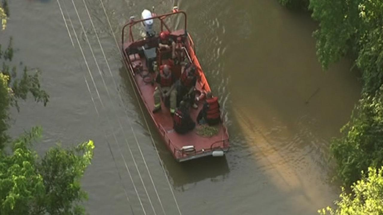 Family rescued from flooding near San Jacinto River