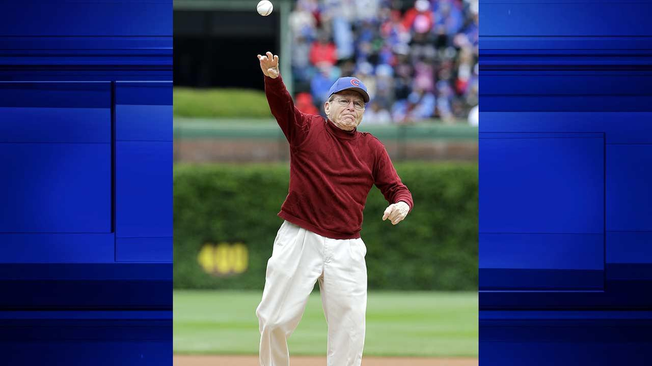Tony Gianunzio throws out a ceremonial first pitch before an interleague baseball game between the Kansas City Royals and the Chicago Cubs Sunday, May 31, 2015, in Chicago.