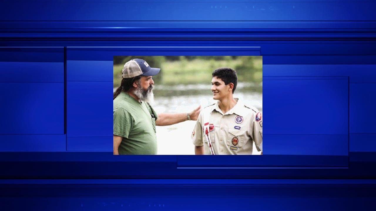 Boy Scout Zachary Jaramillo interacts with his former Scout Master, Scott Ryan, who first introduced Jaramillo to white-water canoeing and kayaking back in the Scouts.