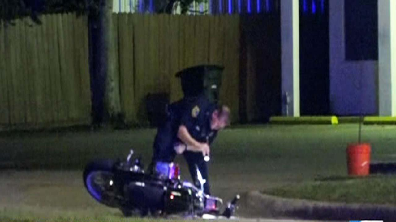 Investigators at the scene of a motorcycle accident with a pedestrian in north Houston