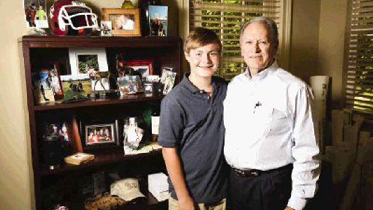 Reese Wilson, 14, of The Woodlands, pictured with his grandfather, Virgil Yoakum has been named a youth ambassador for The National Tourette Syndrome Association.