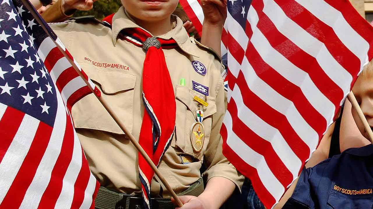 Boy Scout board approves end to blanket ban on gay adults