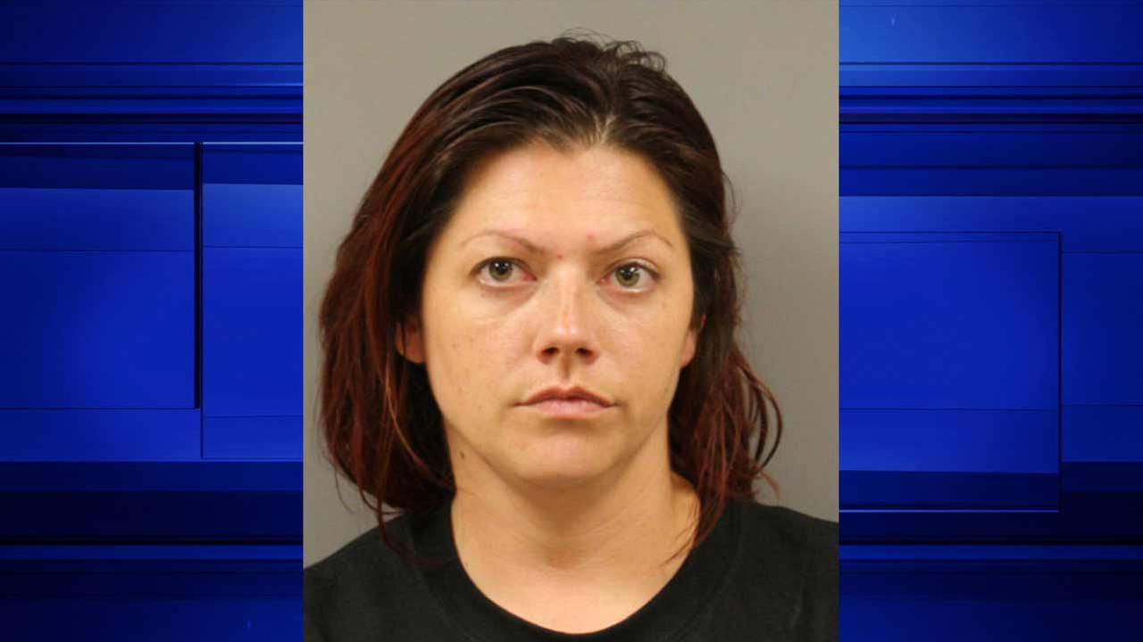Woman accused of stealing gear from fire department