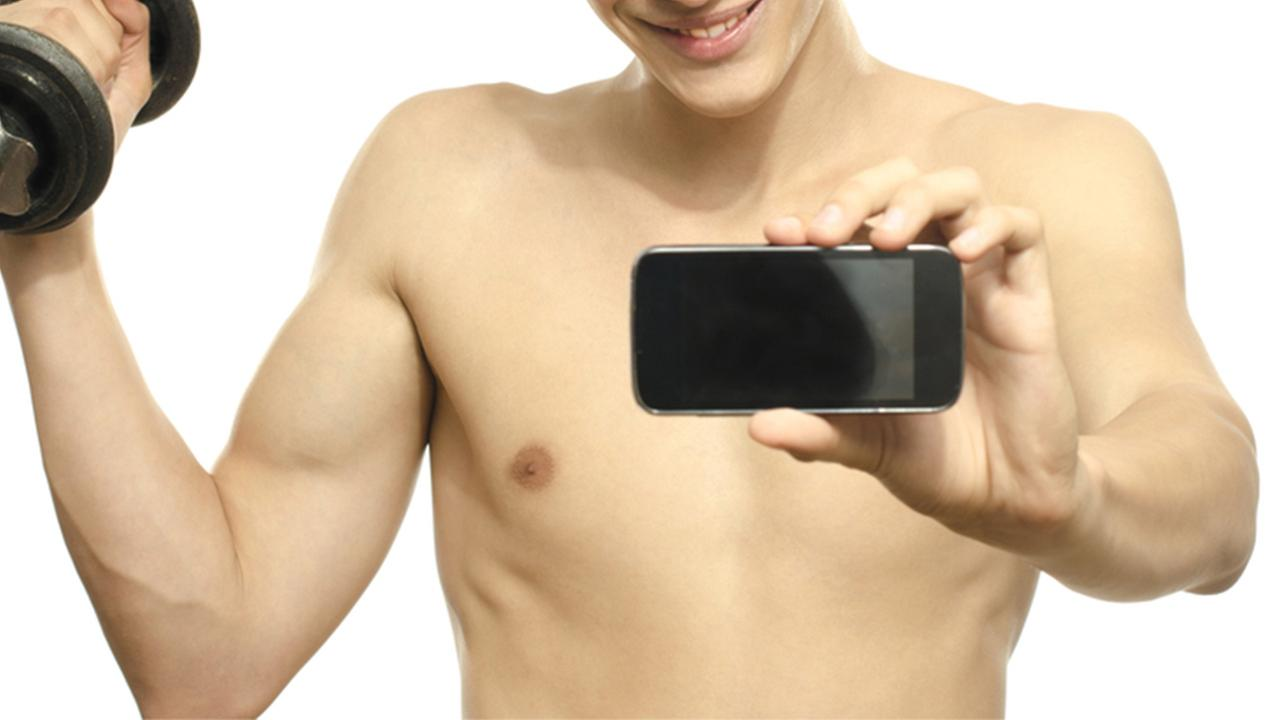 Man taking photo shirtless