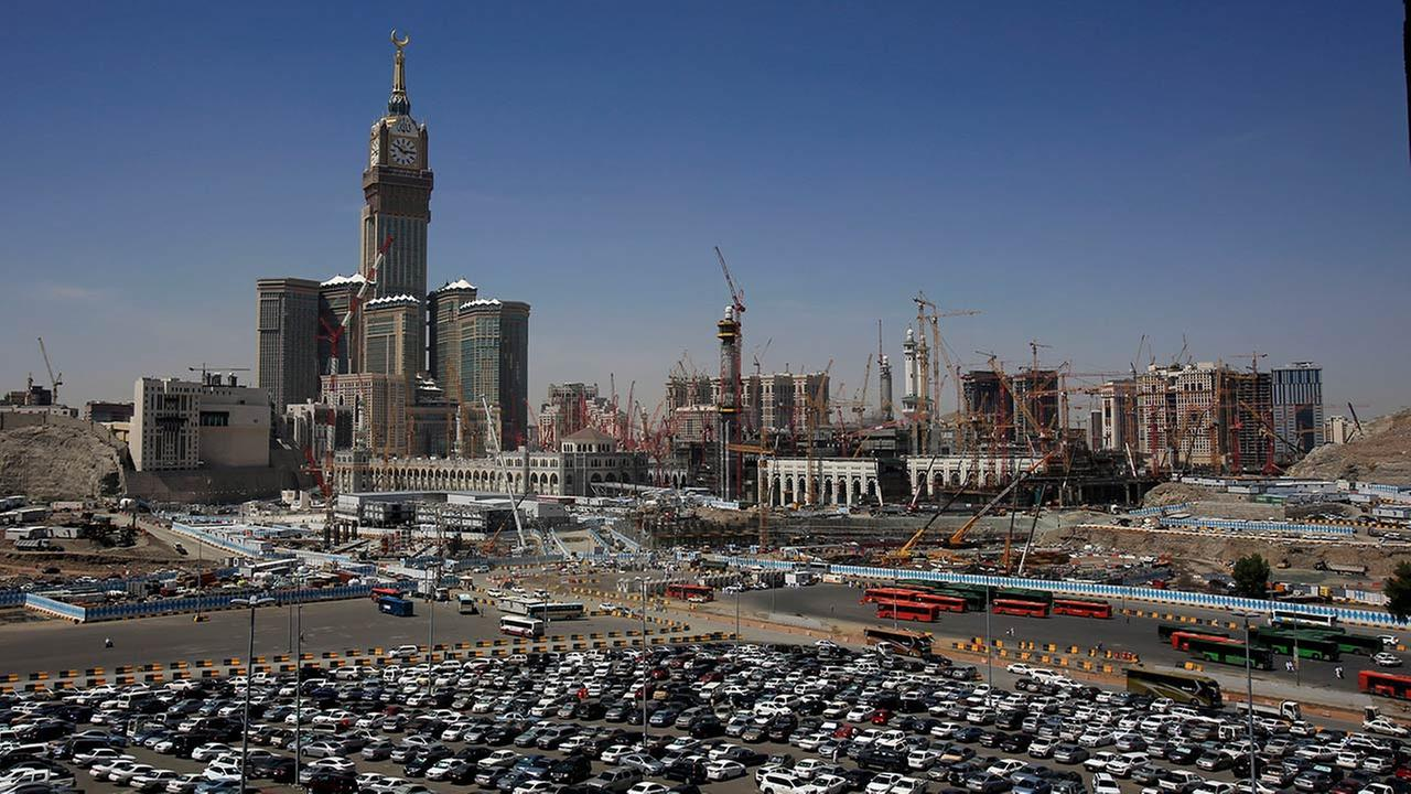 In this Tuesday, May 13, 2014 photo, construction cranes and scaffolding dominate the minarets and entries to the Kaaba at Mecca, Saudi Arabia