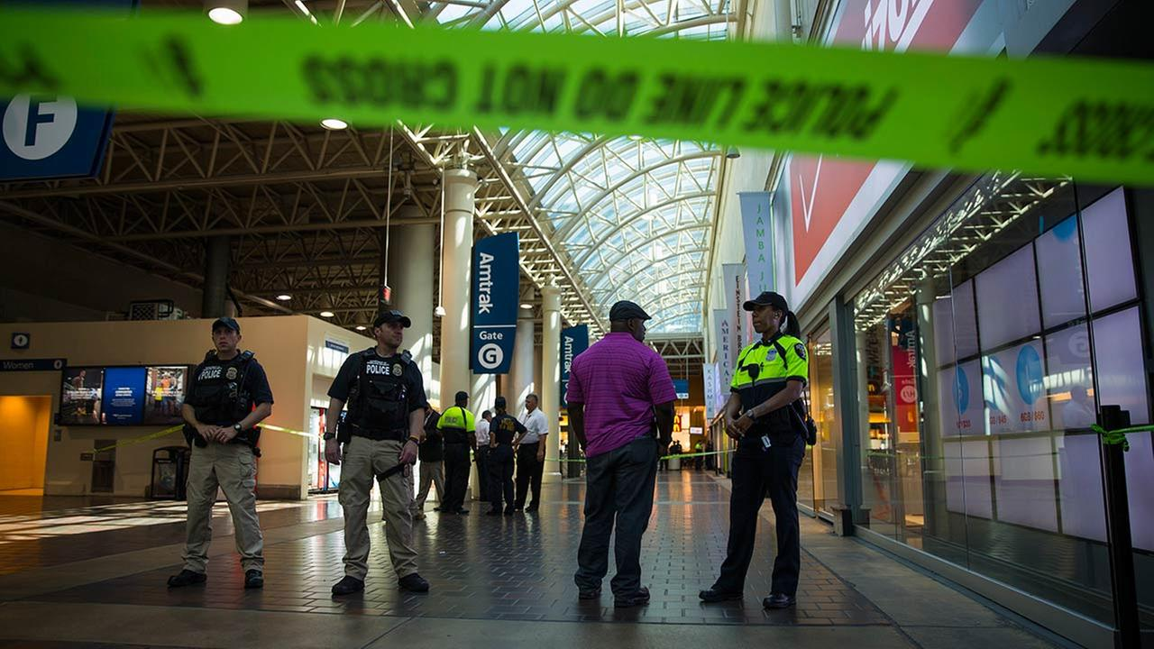 Police and emergency responders stand outside a McDonalds located inside Union Station in Washington, Friday, Sept. 11, 2015