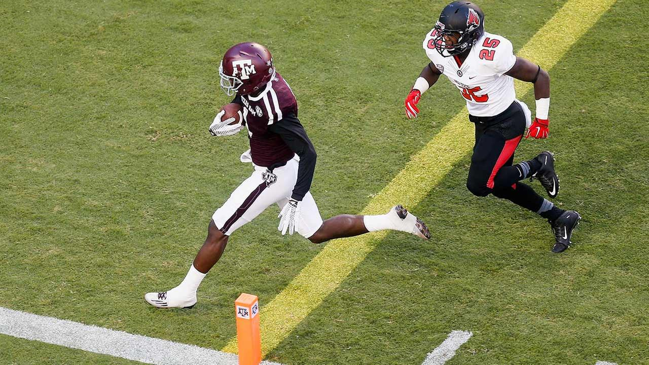Texas A&M defensive back DeVante Harris (1) beats Ball State running back Darian Green (25) to the end zone after intercepting a passs.