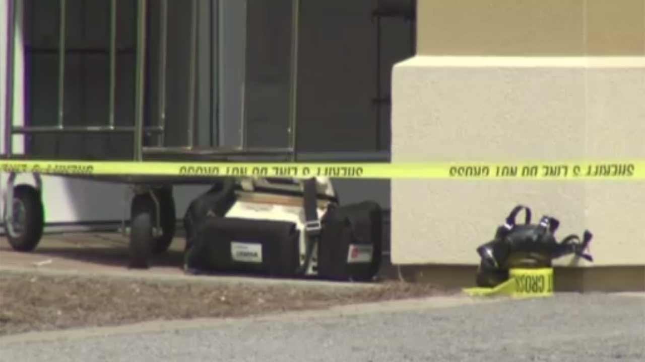 Gunman kills Florida deputy outside lawyer's office