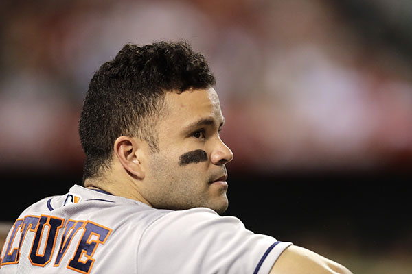 Houston Astros Jose Altuve watches from the dugout during the fifth inning of a baseball game against the Los Angeles Angels, Saturday, Oct. 1, 2016, in Anaheim, Calif.