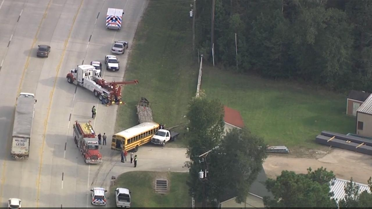 Two students transported to hospital after wreck involving school bus in Conroe