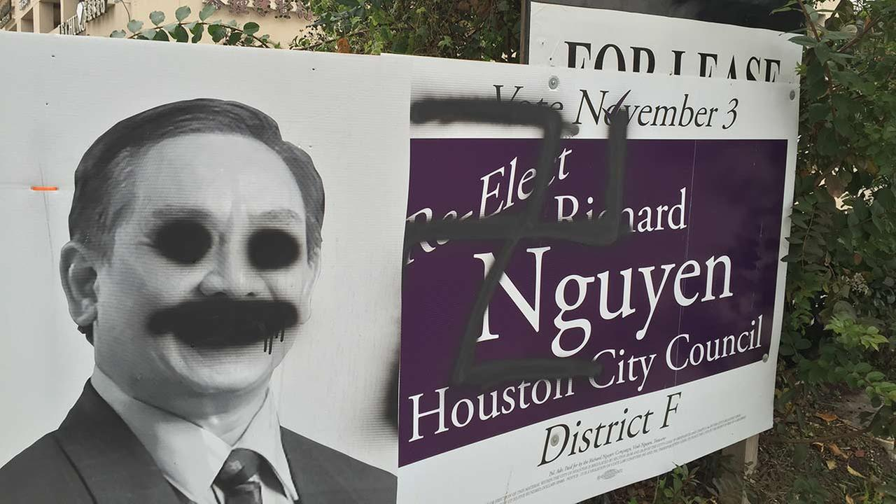 Political candidate's signs defaced with swastikas
