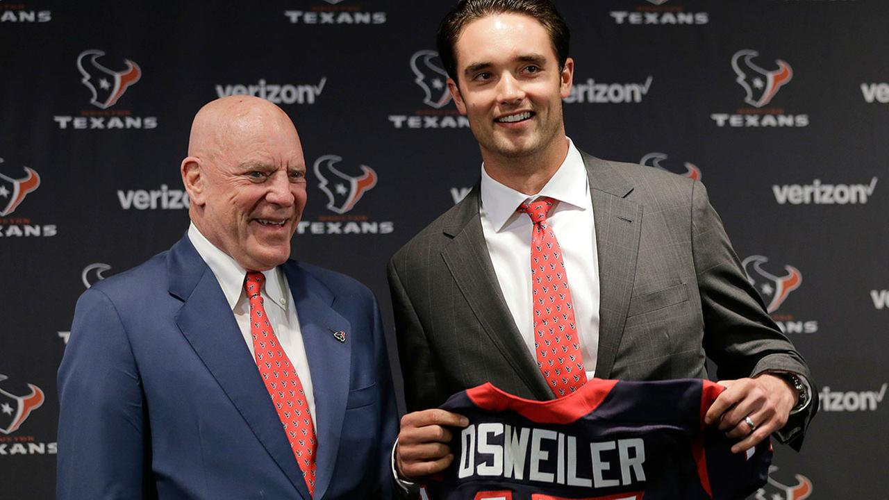 Brock Osweiler holds up his Texans jersey with team owner Bob McNair.