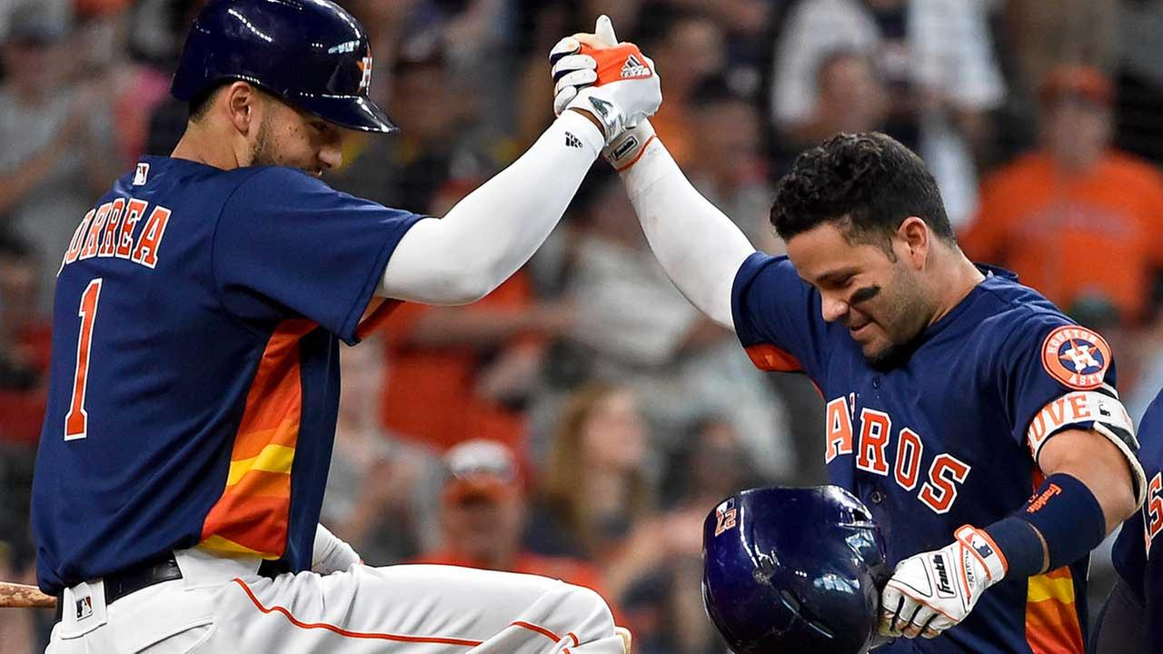 Carlos Correa and Jose Altuve celebrate a 13-3 win over the Angels and a series sweep.