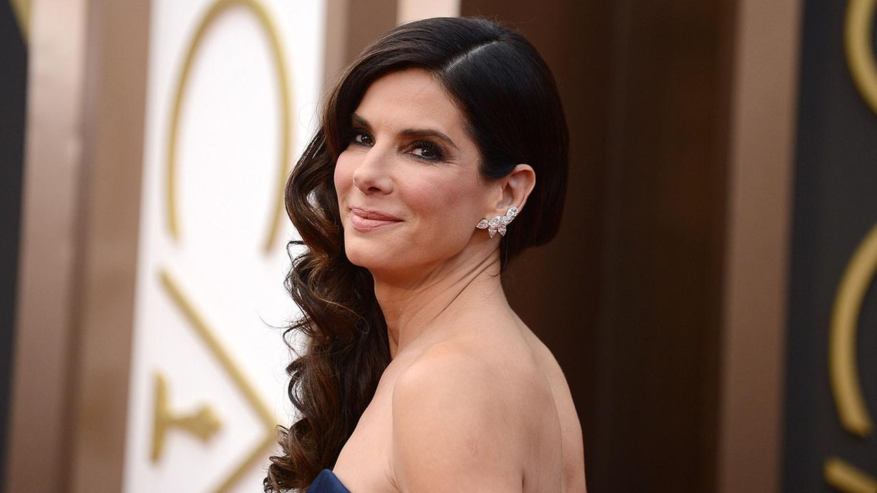 In this March 2, 2014 photo, Sandra Bullock arrives at the Oscars at the Dolby Theatre, in Los Angeles