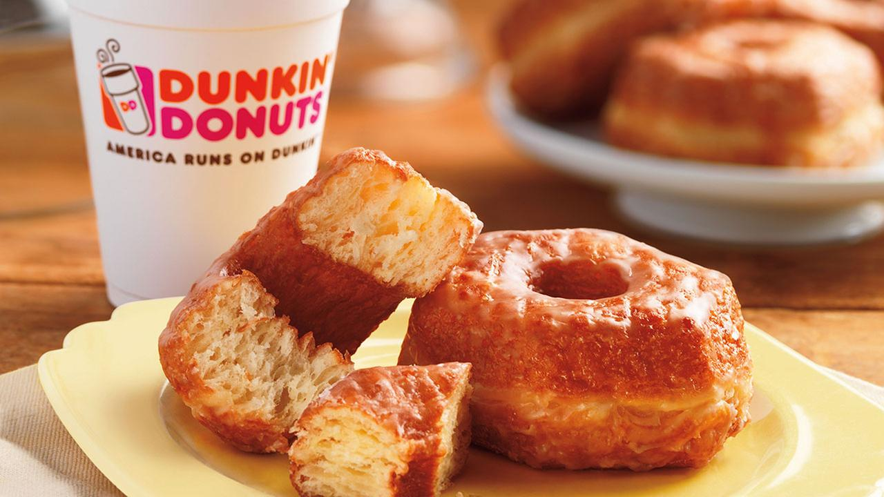 This product image provided by Dunkin Donuts shows the chains new Croissant Donut, which will be launched nationally for a limited time starting Nov. 3, 2014.