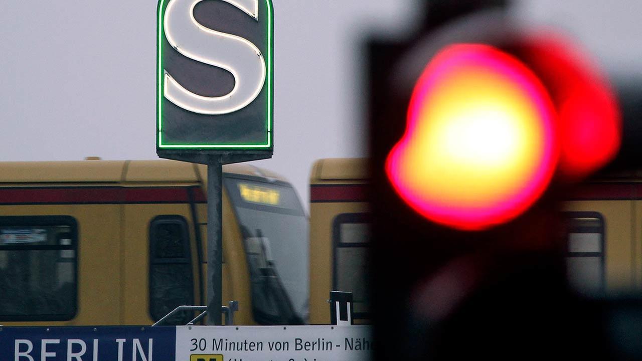 A Berlin subway train passes a company logo in Berlin, Germany, Tuesday, Jan. 4, 2011