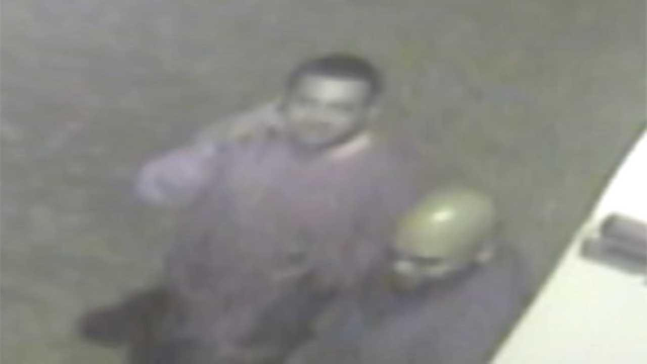 The photos show the suspects using cell phones, believed to be communicating with a third suspect who later arrived at the site in a 2009 Ford F-350