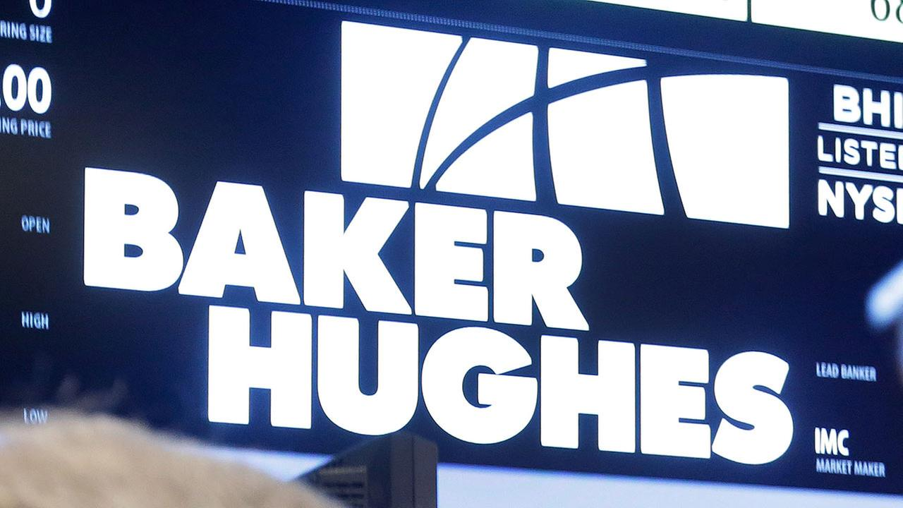 Traders gather at the post that handles Baker Hughes on the floor of the New York Stock Exchange