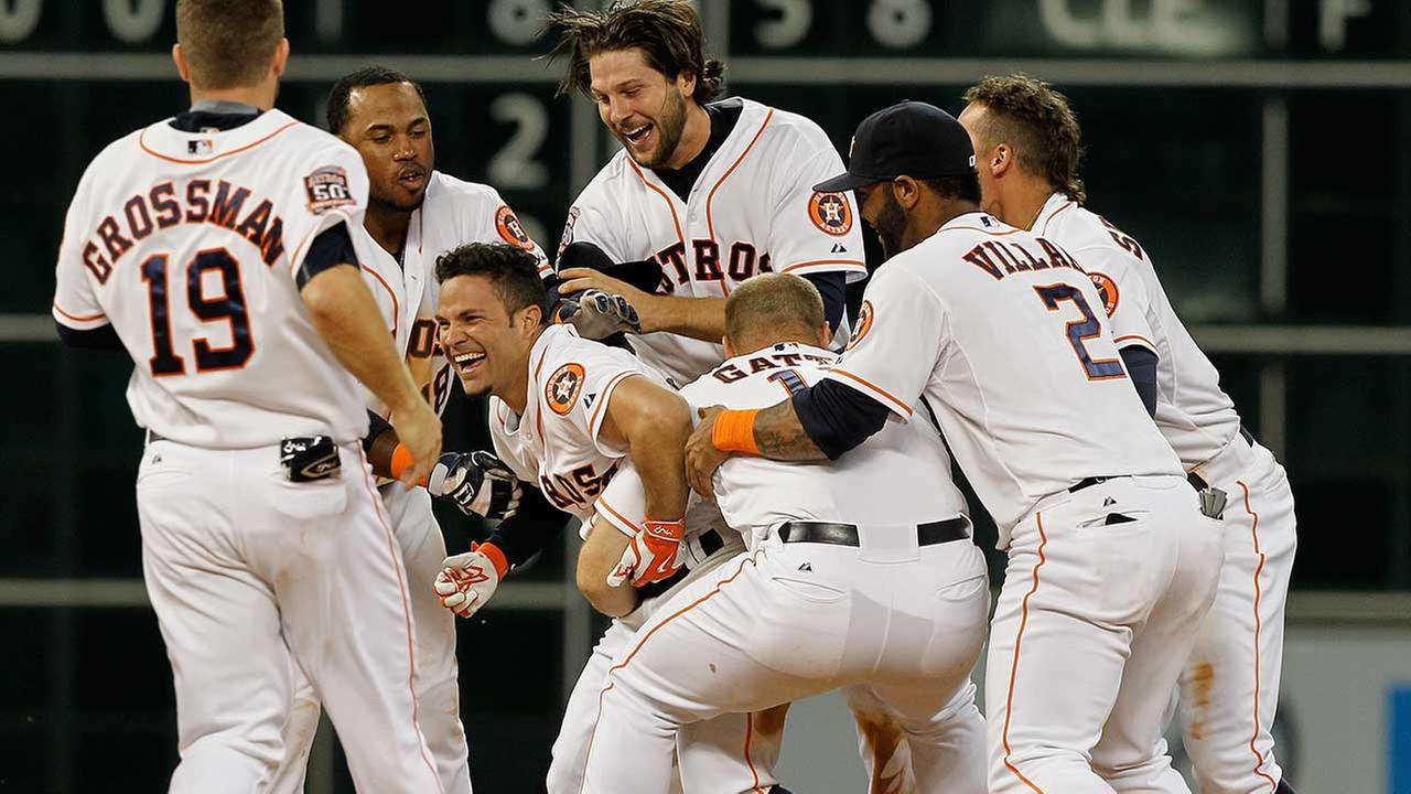 Jose Altuve is mobbed after hitting the game-winning hit to cap off an extraordinary April