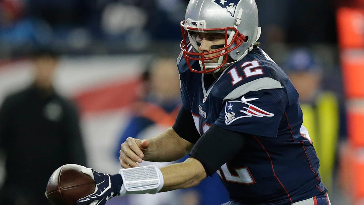 In this Sunday, Jan. 18, 2015, photo New England Patriots quarterback Tom Brady hands the ball off during the first half of the NFL football AFC Championship game