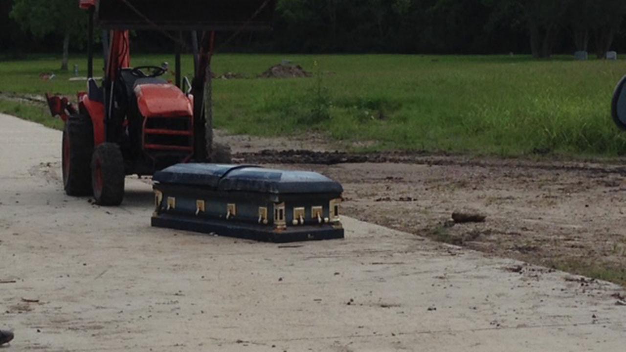 Man finds occupied casket on southwest Houston road