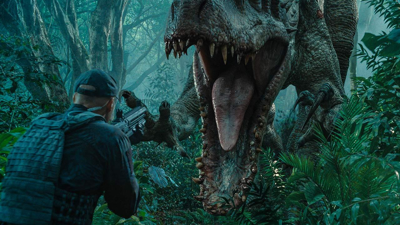 This photo provided by Universal Pictures shows, Indominus Rex about to attack in a scene from the film, Jurassic World, directed by Colin Trevorrow