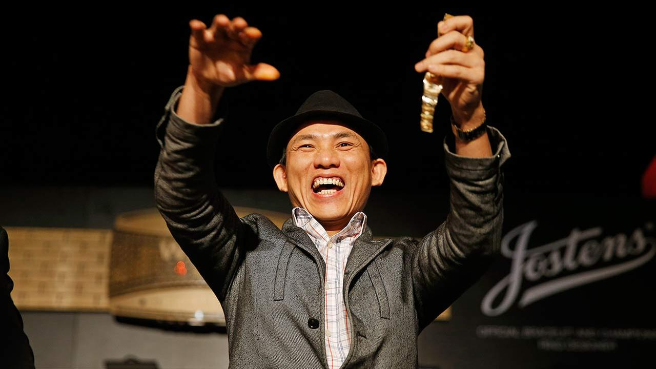Christian Pham celebrates during a bracelet ceremony after he won the World Series of Poker No-Limit Deuce-to-Seven Lowball Draw tournament Friday, June 12, 2015, in Las Vegas