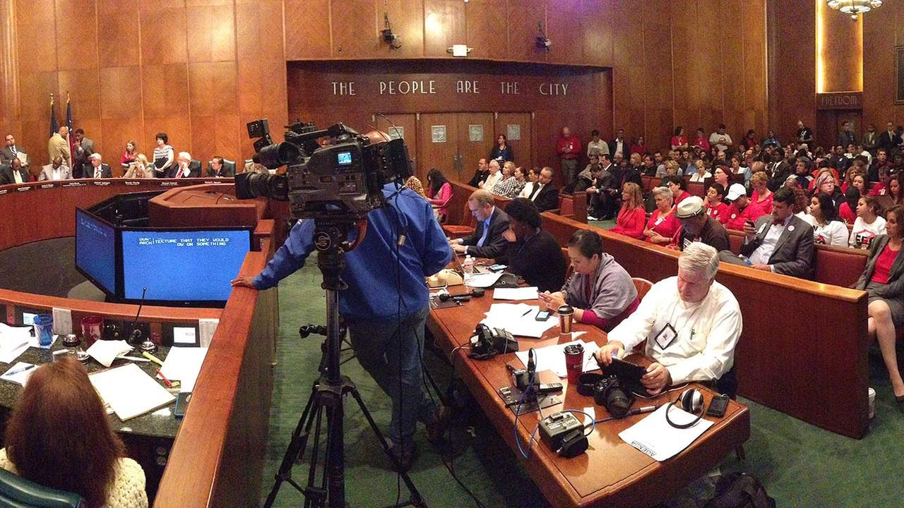 Supporters of the non-discrimination ordinance, nick-named HERO, dressed in red and joined opponents in the gallery of Houstons city council
