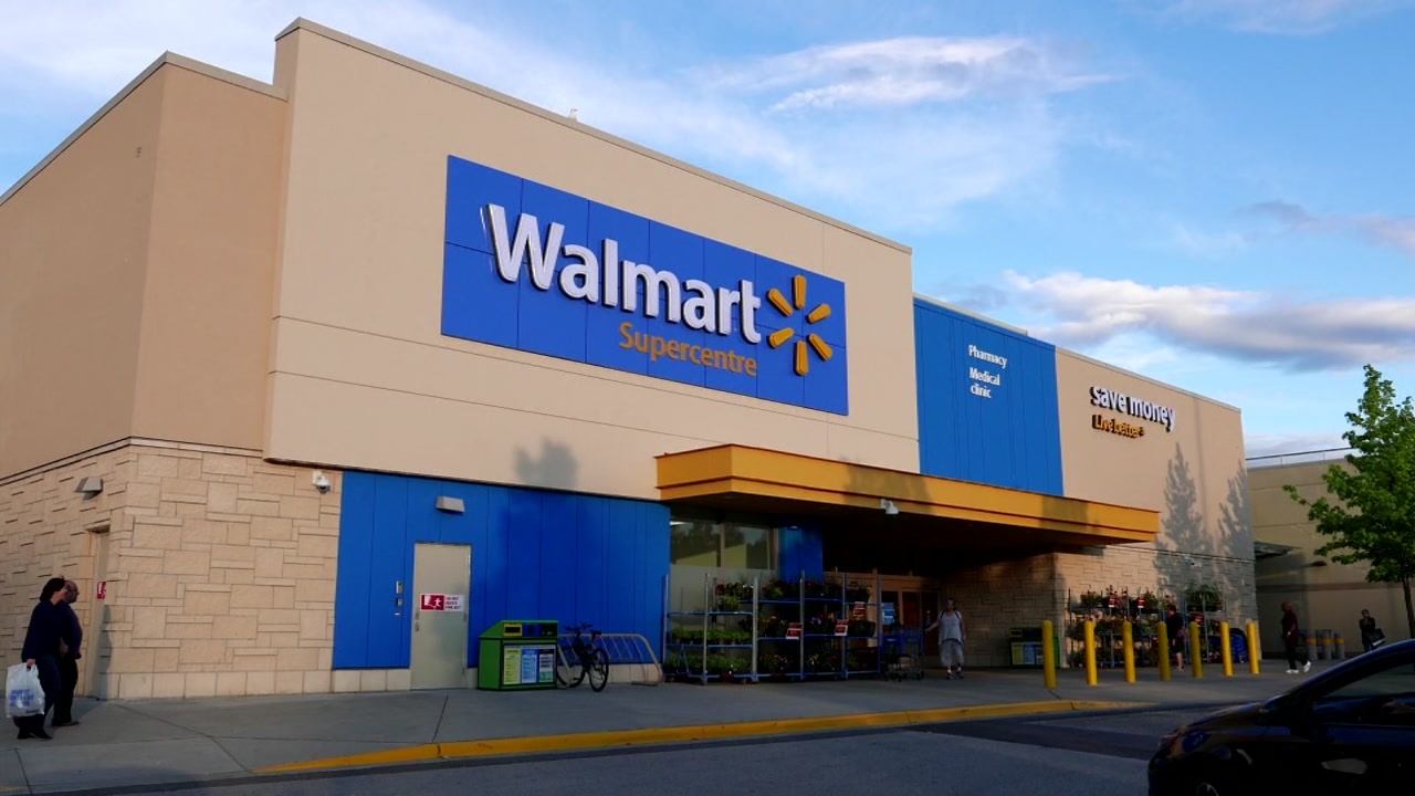 A woman drinking wine from a Pringles can while driving an electric shopping cart around the parking lot has been banned from Walmart.