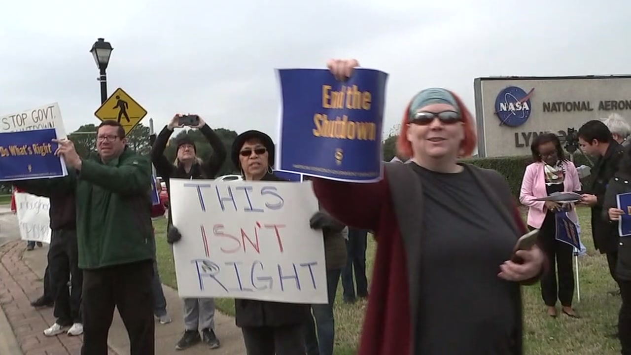 Federal workers at NASA protest shutdown.