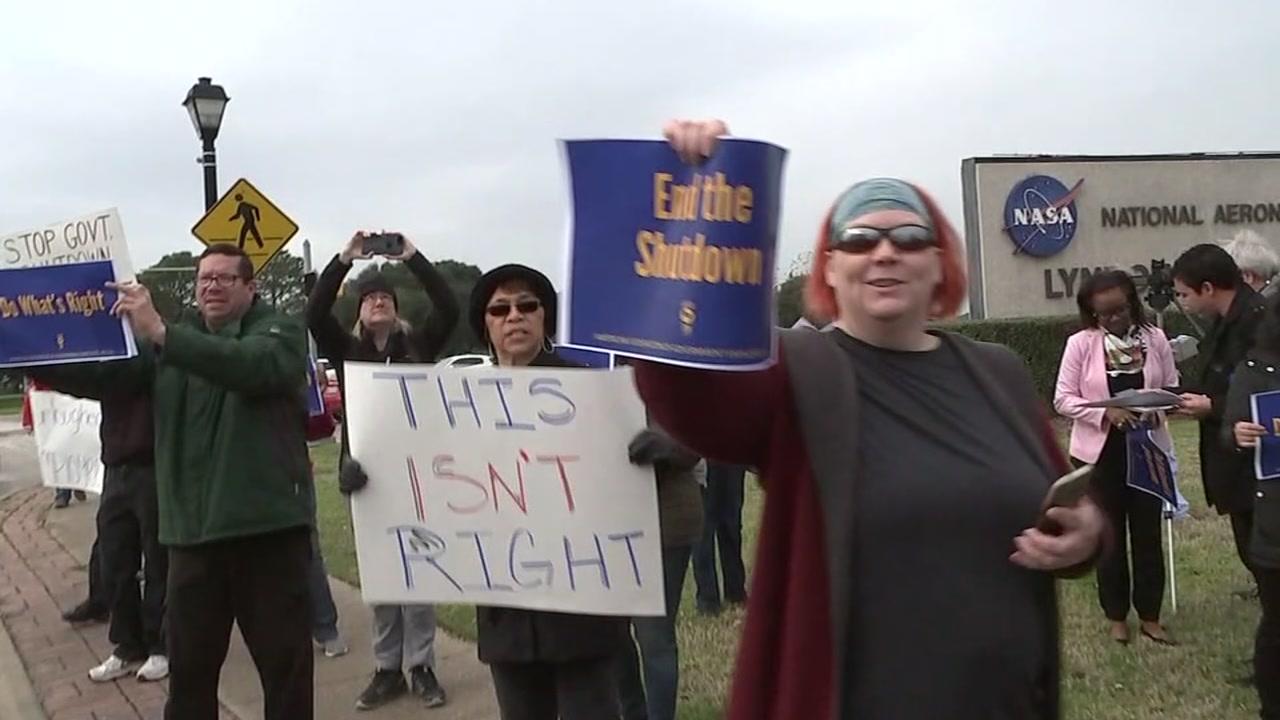 Federal workers at NASA protest shutdown.