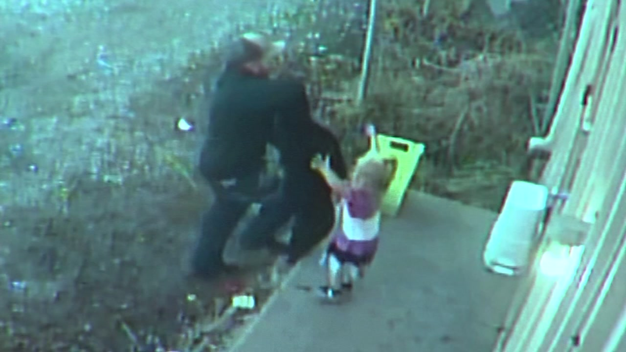 Stunning surveillance video shows a man breaking into a flower shop with a little girl by his side.