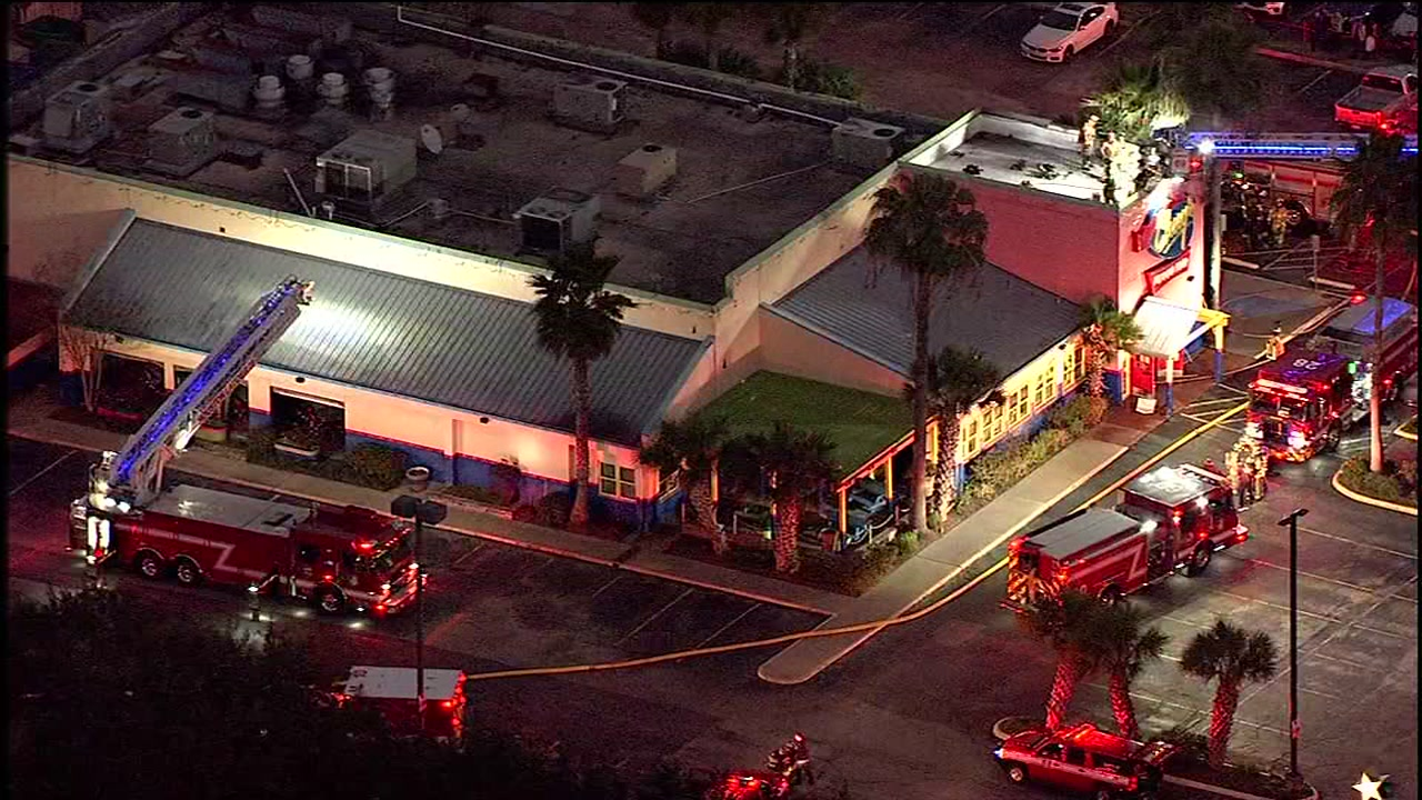 Firefighters are on the roof after a fire at Chuys on Westheimer Road near Shady Lane.