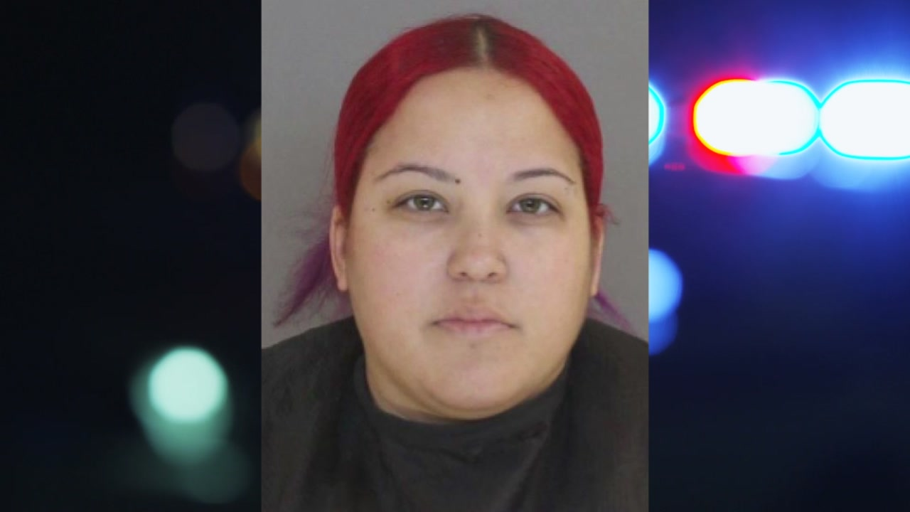 A woman has been arrested after deputies say she posted a video of her pouring water on her nine-month-old daughter.