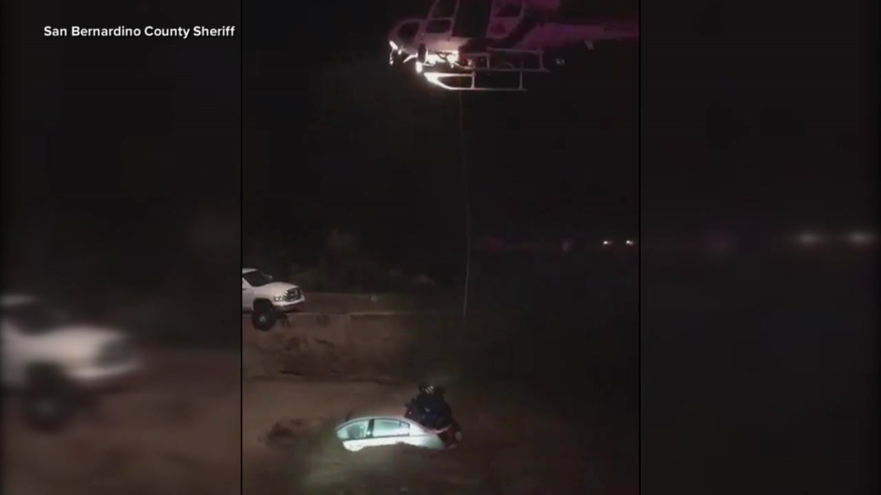 While dodging power lines and fighting rain with 40 MPH winds, deputies in a helicopter rescued an elderly man trapped in his car in rushing water.