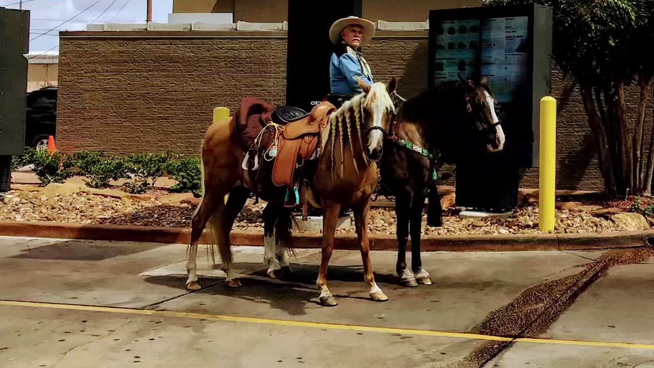 Cowboy rides horse through drive-thru