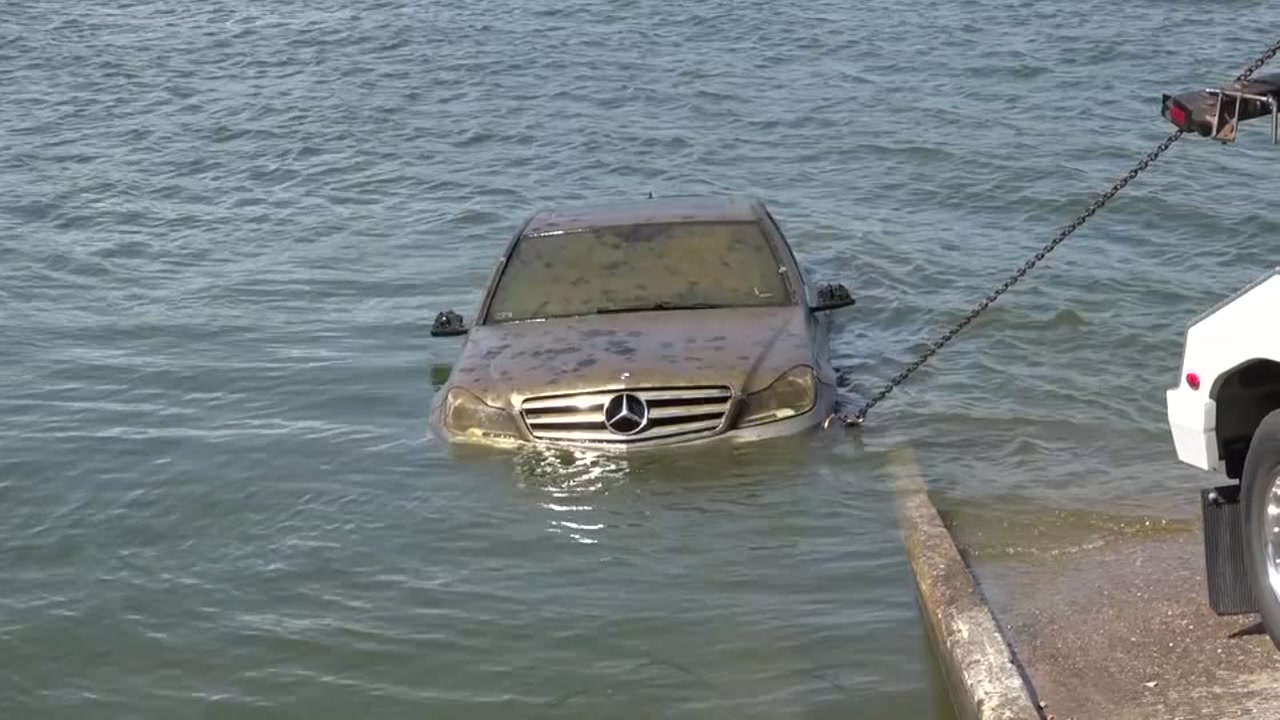 A vehicle was pulled out of Lake Conroe after workers discovered it with sonar equipment.