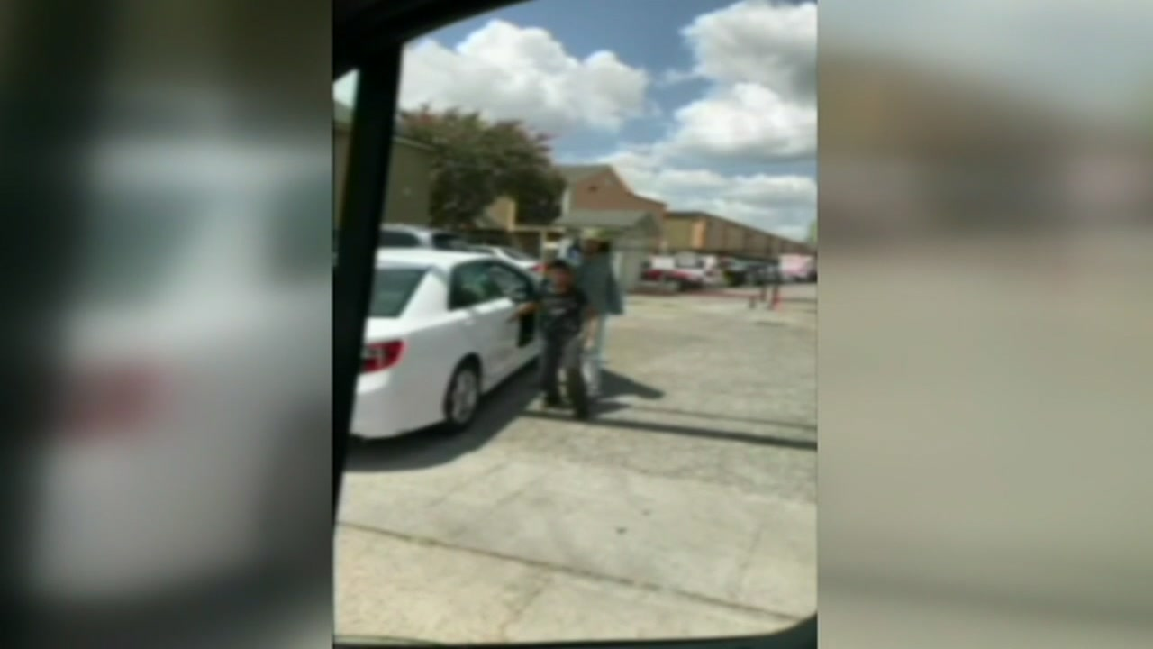 Intense video shows a store clerk attempting to push a boy accused of stealing into his car.