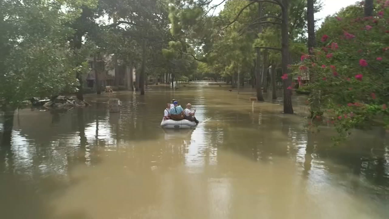 A boat travels up a Houston street on Sept. 1, 2017.