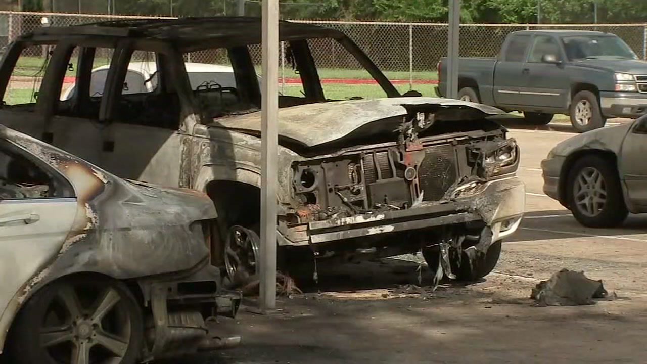 Authorities are investigating whether cars at an apartment complex were set on fire.