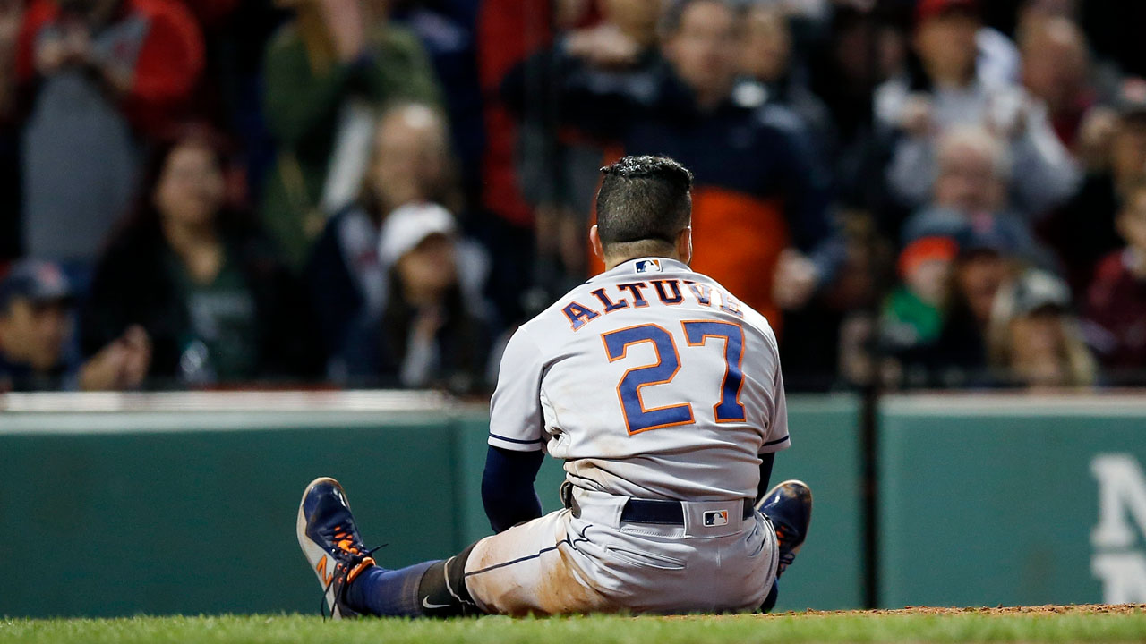 Astros second baseman Jose Altuve gets called out at home plate in a controversial play.