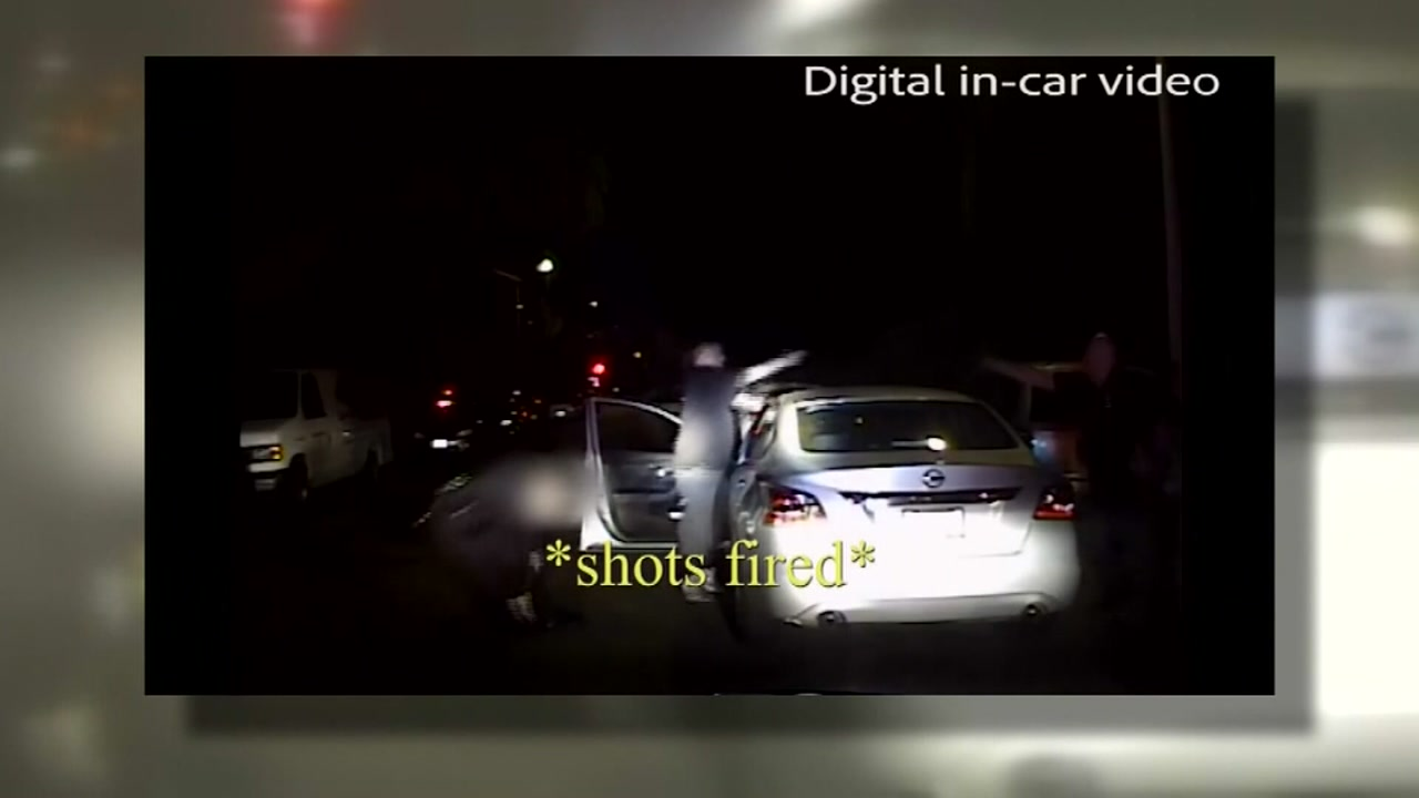 Dramatic new video shows the moments an officer is shot in the leg. Warning: Video may be hard for some to watch.