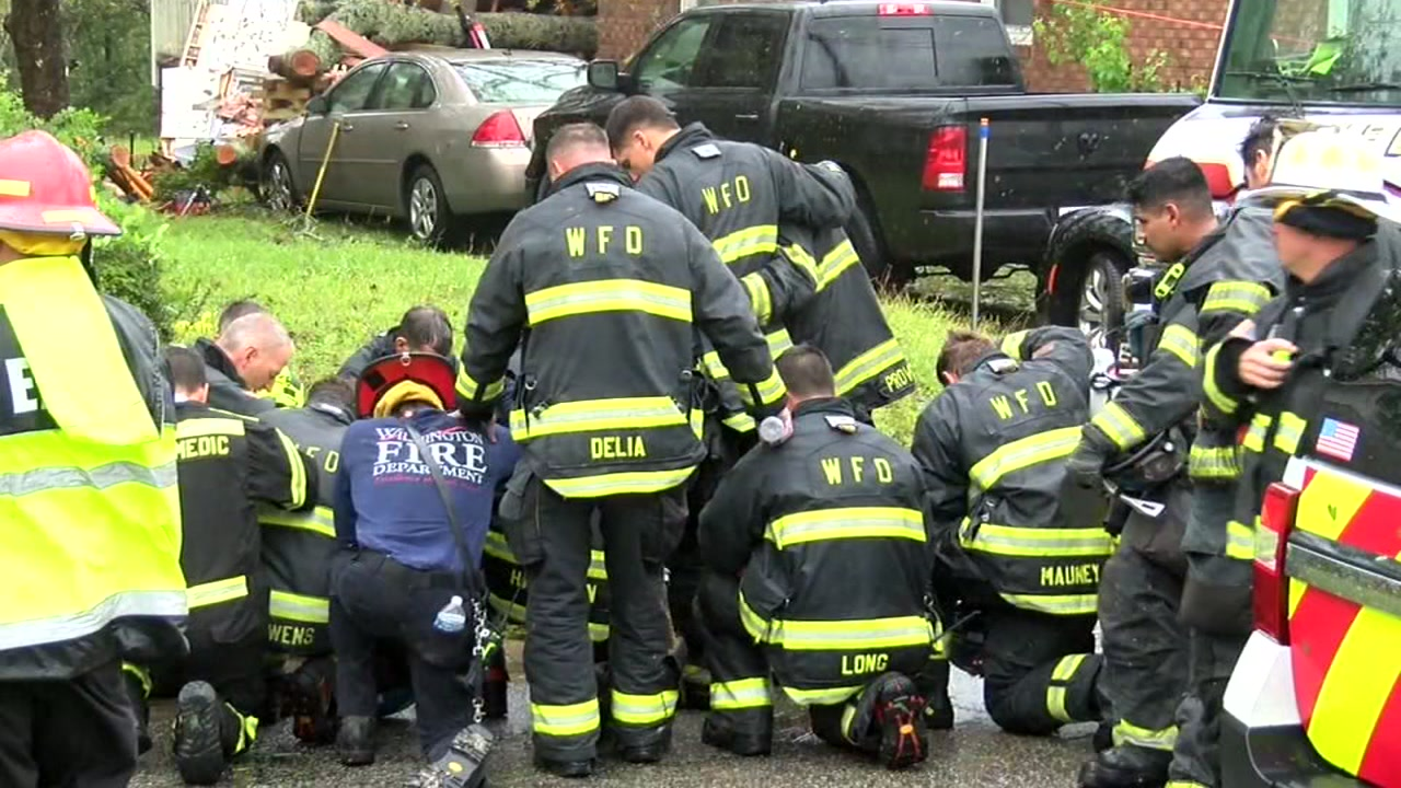 Firefighters pray after mom and child found dead during Florence